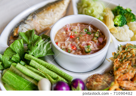 Shrimp paste sauce with fried mackerel and vegetable. Thai food 71090482