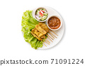 Pork Satay with Peanut Sauce and pickles which are cucumber slices and onions in vinegar. Isolated on white background 71091224
