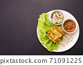 Pork Satay with Peanut Sauce and pickles which are cucumber slices and onions in vinegar. Isolated on white background 71091225