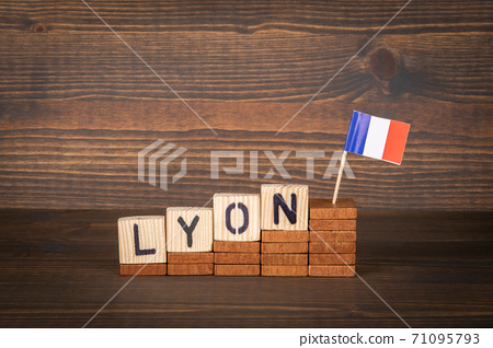 LYON. City in France. Steps and flag on a wooden background 71095793