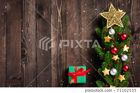 tree fresh fir branches and ornaments gift box 71102535