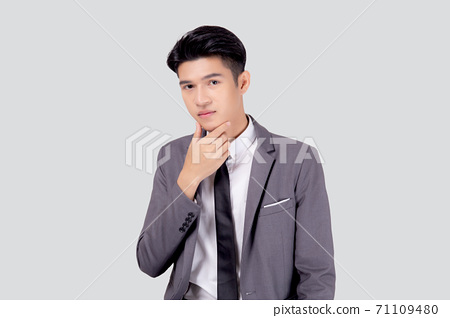 Portrait young asian business man in suit with smart thinking idea isolated. 71109480