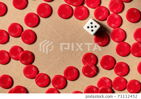 Board games frame with a place for text, top shot of red pieces and a die 71112452