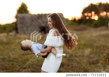 mom and son have fun together. Enjoying life together concept. Happy mother and son having fun outdoors on a sunny summer day. Mother's Day 71131021