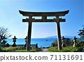 Otorii towering against the backdrop of the clear blue sky and the Seto Inland Sea 71131691