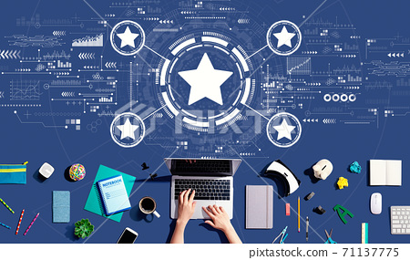 Rating star concept with person using a laptop 71137775