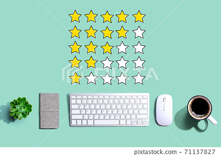 Rating with yellow stars with a computer keyboard 71137827