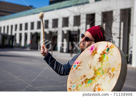 Sacred man holding native drum downtown 71138906
