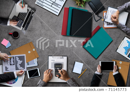 Top view group of professional business meeting and discussing strategy with new startup project.Creative business people planning and brainstorm with document report at home office. 71145773