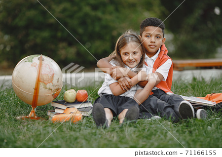 Little african boy study with caucasian girl 71166155