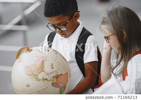 Little african boy study with caucasian girl 71166213