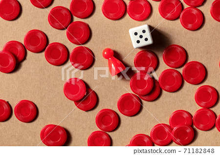 Board games concept, red pieces, shot from the top with a die 71182848