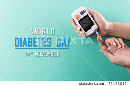 Healthcare and medical concept, The diabetic measures the level of glucose in the blood. World Diabetes day, 14 November. 71188815