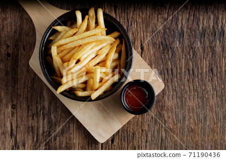 French fries with ketchup on a dark wood background. fastfood snack. 71190436