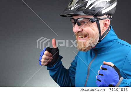 portrait of happy laughing bearded cyclist. 71194818