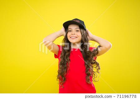Summer sun protection cap. Girl long curly hair wear cap.  71196778