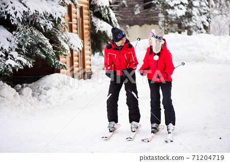 Skiing, snow, winter fun, happy family is skiing in the forest. 71204719