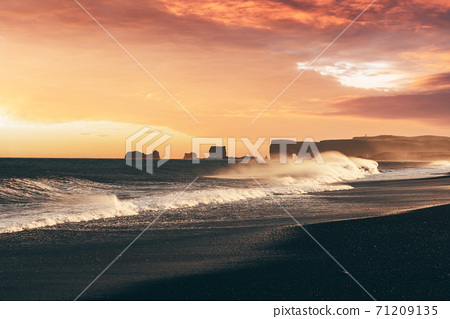 Incredible sunset view on stormy Atlantic ocean on Black Beach 71209135