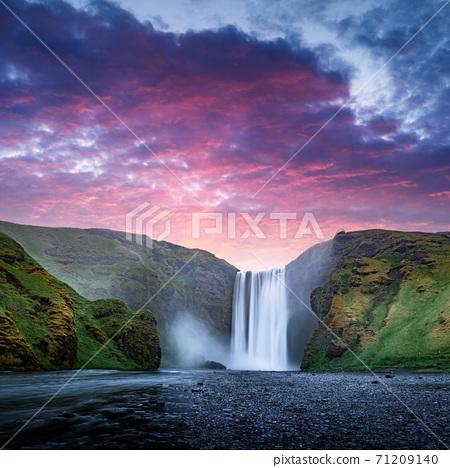 Famous Skogafoss waterfall on Skoga river in sunrise time 71209140
