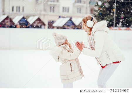 Cute and beautiful family in a winter city 71212467