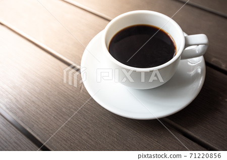 Coffee in a glass on a wooden floor The drink is popular all over the world. Products from Asia and Blasil 71220856