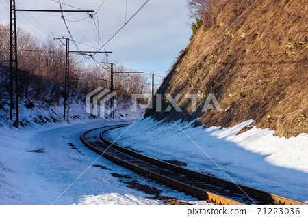railroad in mountains. frosty winter landscape. transportation scenery 71223036