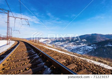 railroad in mountains. frosty winter landscape. transportation scenery 71223037