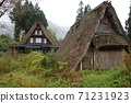 A rare primitive gassho-zukuri with a roof that extends to the ground 71231923