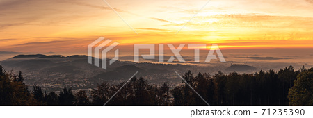 Panorama of Graz city covered if fog on autumn morning during sunraise. 71235390