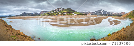 Panoramic view of colorful volcanic rainbow Landmannalaugar mountains, camping site and flooding with river in Iceland, summer, wide angle 71237506