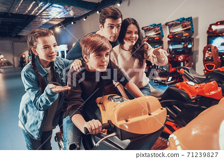Sister supports brother who rides high speed bike. 71239827