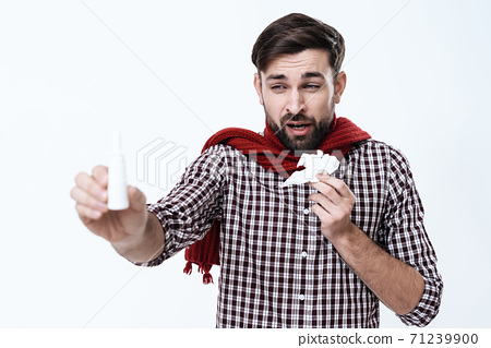 Man stands with a napkin in hand and feels a cold. 71239900