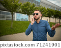Aggressive businessman screaming at smartphone while having mobile conversation 71241901