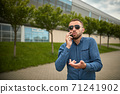 Aggressive businessman screaming at smartphone while having mobile conversation 71241902