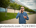 Man arguing over smart phone. Ouch someone is mad at me. Portrait of intense 71241903