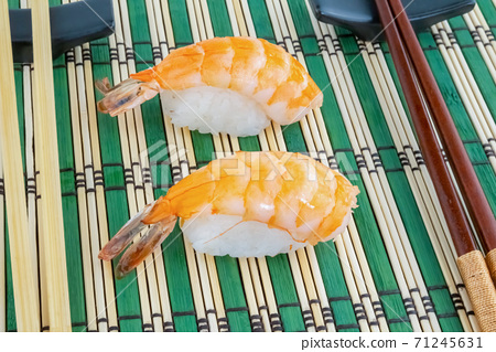 fresh sushi salmon on rice steam on bamboo mat close-up 71245631