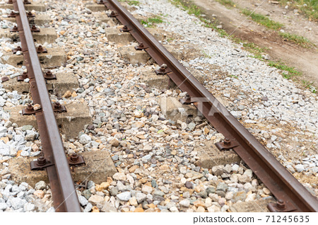 railroad tracks iron rails vertical on gravel background 71245635