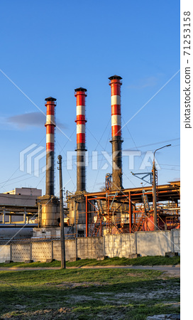 industrial enterprises with pipes against the blue sky 71253158