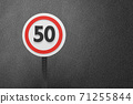 3D Illustration of a Speed limitation sign board pattern on dark background, textured traffic rules concept. 71255844