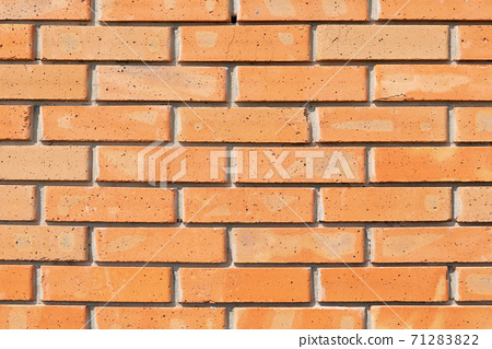 wall of new red brick, natural material, baked clay, close-up 71283822