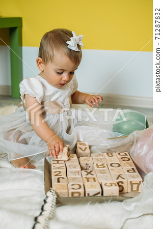 Sustainable eco-friendly safe wooden toys for baby and kids. Baby girl play with wooden blocks made with organic, renewable eco-friendly materials 71287832
