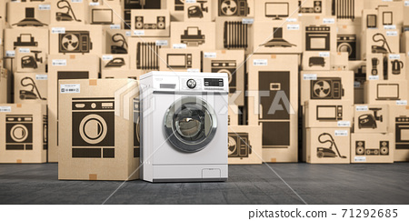 Washing machine in warehouse with household appliances and kitchen electronics in cardboard boxes. Online purchase, shopping  and delivery concept. 71292685