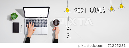 2021 goals with person using laptop computer 71295281