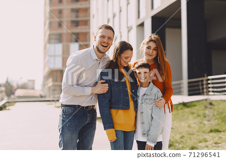 Cute family walks in a spring city 71296541