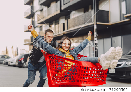 Cute family playing with a carts in a city 71296563