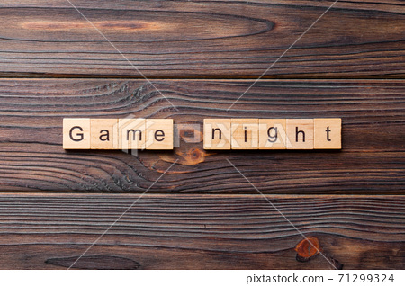 Game Night word written on wood block. Game Night text on wooden table for your desing, concept 71299324