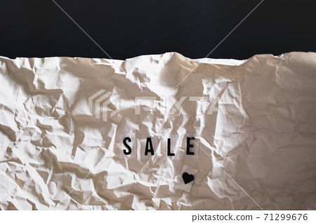 letters text sale on wrapped paper 71299676
