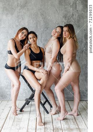 Group of women with different body and ethnicity posing together to show the woman power and strength. body positive concept 71299835