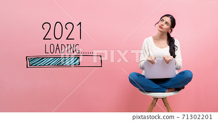 Loading new year 2021 with woman using a laptop 71302201