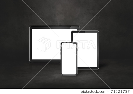 Mobile phone and digital tablet pc on dark concrete office scene 71321757